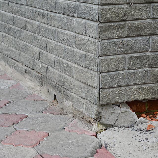 broken foundation house brick wall